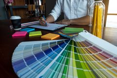 Graphic designer choose colors from the color bands samples for design .Designer graphic creativity working concept.  royalty free stock image