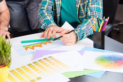 Graphic designer choosing color chart stock images