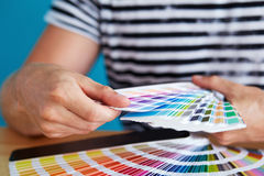 Graphic designer choosing a color. From the sampler Royalty Free Stock Photo