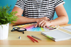 Graphic designer choosing a color. From the sampler royalty free stock image