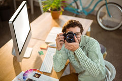 Graphic designer clicking photo from digital camera Stock Photography