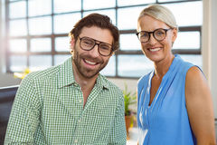Graphic designer and colleague smiling in office Royalty Free Stock Image