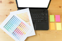 Graphic designer desk table with computer, sticky note and color Stock Photography