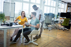 Graphic designer discussing over color swatch with a colleague. In office royalty free stock images