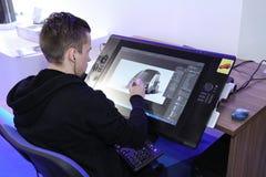 Graphic designer drawing car