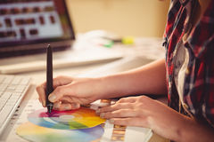 Graphic designer drawing on colour chart. In office Stock Photos