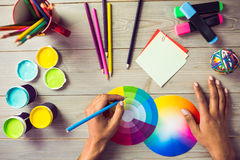 Graphic designer drawing on colour chart stock image
