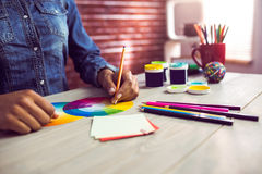 Graphic designer drawing on colour chart. At workplace royalty free stock image