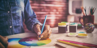 Graphic designer drawing on colour chart. At workplace Stock Images