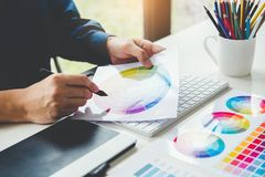 Graphic designer drawing on graphics tablet at workplace.  royalty free stock image