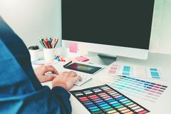 Graphic designer drawing on graphics tablet at workplace.  royalty free stock photos