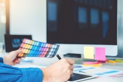 Graphic designer drawing on graphics tablet at workplace.  stock photos