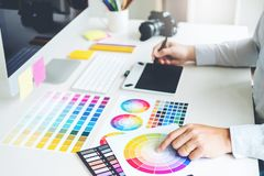 Graphic designer drawing on graphics tablet at workplace royalty free stock photography