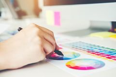 Graphic designer drawing on graphics tablet at workplace.  stock photo