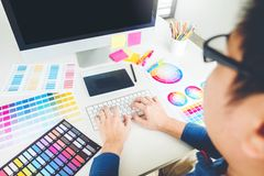 Graphic designer drawing on graphics tablet at workplace.  royalty free stock photo