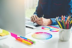 Graphic designer drawing on graphics tablet at workplace.  stock image