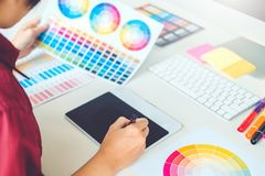 Graphic designer drawing on graphics tablet at workplace.  stock images