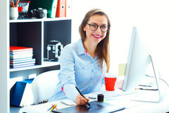 Graphic designer drawing something on graphic tablet Stock Photo