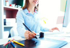 Graphic designer drawing something on graphic tablet Royalty Free Stock Photography