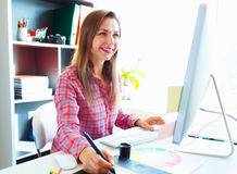Graphic designer drawing something on graphic tablet at the work Royalty Free Stock Photos