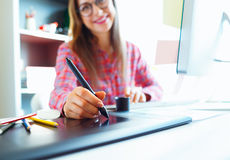 Graphic designer drawing something on graphic tablet at the work Royalty Free Stock Photography