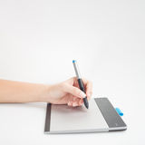 Graphic designer hands writing on digital tablet Royalty Free Stock Images