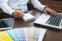 Graphic designer job with colour charts at a modern office.  stock photography