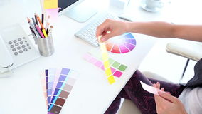 Graphic designer looking at colour samples stock video