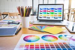 Graphic designer object tool and color swatch samples at workspace royalty free stock photography