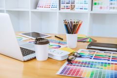 Graphic designer object tool and color swatch samples at workspace.  royalty free stock photos