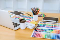 Graphic designer object tool and color swatch samples at workspace.  stock photography