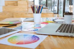 Graphic designer object tool and color swatch samples at workspace.  stock images