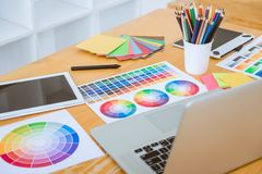 Graphic designer object tool and color swatch samples at workspace stock photo