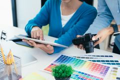 Graphic designer and photo editor working. royalty free stock image