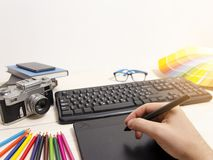 Graphic designer point of view of desk. POV , white clean copy space background stock photography