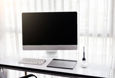 Graphic designer's workspace with a pen tablet, a computer Royalty Free Stock Image