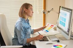 Graphic designer sitting at work. Illustrator. web designer. freelancer.  royalty free stock photo