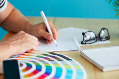 Graphic designer. At sketching the design in office royalty free stock photography