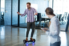 Graphic designer standing on hoverboard Stock Photos