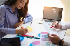 Graphic designer teamwork brainstorming about color swatch in new project website at office royalty free stock photo