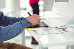 Graphic designer at their desk Stock Images