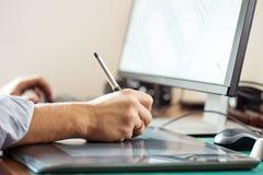 Graphic designer using digital tablet Stock Images