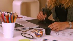 Graphic designer using digitizer at her desk stock video