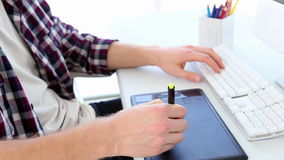 Graphic designer using digitizer at his desk stock footage