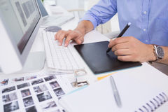 Graphic designer using digitizer at his desk Royalty Free Stock Images