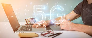Graphic designer using 5G network digital hologram 3D rendering. Graphic designer on blurred background using 5G network digital hologram 3D rendering Stock Photo