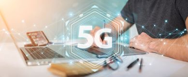 Graphic designer using 5G network interface 3D rendering. Graphic designer on blurred background using 5G network interface 3D rendering Stock Photo