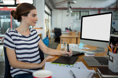 Graphic designer using  graphic tablet and desktop Stock Photography