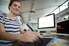 Graphic designer using graphic tablet and desktop Stock Photos