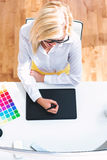 Graphic designer using her graphic tablet. In an office Stock Photo